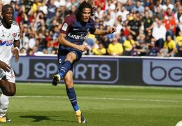 PSG's Edinson Cavani, right, scores a goal during the French major soccer league opening match between Paris Saint-Germain and Amiens at the Parc des Princes stadium in Paris Saturday, Aug. 5, 2017. (AP Photo/Francois Mori)